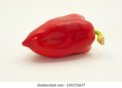 Bright red pepper with green tail on white background.