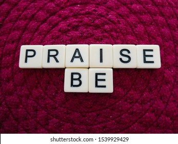 """Bright red pink colored background sign with the words """"PRAISE BE"""" in text lettering, for a vivid and eye catching sign, banner, graphic, poster or placard"""