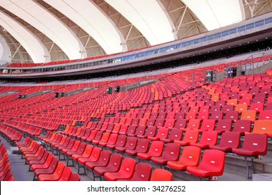 bright red seats in a large international soccer stadium