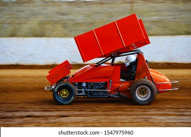 Bright red sprint car driving fast