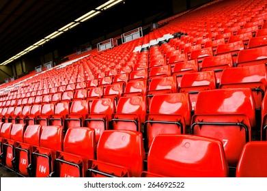 Bright red stadium seat in Liverpool. Horizontal orientation.