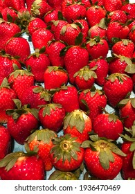 Bright Red Strawberries in pattern with blue background