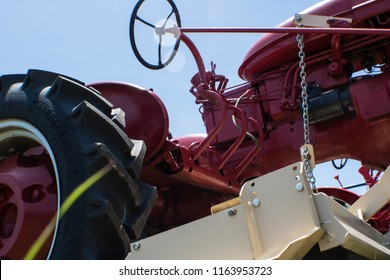 A bright red tractor sits on the side of the interstate in La Grange, TX.