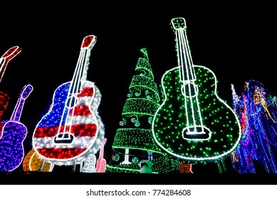 Bright Red, Red White and Blue and Purple and Green Guitars and Holiday Tree with Ornaments lit up with Lights at Mozart's Coffee  on Lake Travis in Austin, Texas
