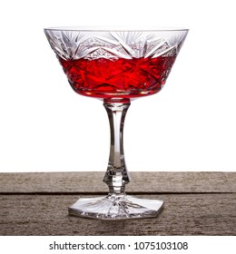 bright red wine in a vintage crystal glass on a white background a delicious alcoholic drink is good for health