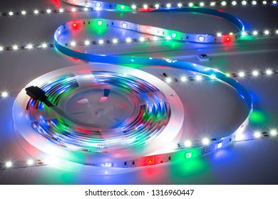 Bright RGB LED stripnon table with white strips electronics energy saving decoration technology background