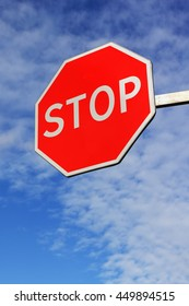 Bright road stop sign. Hanging side