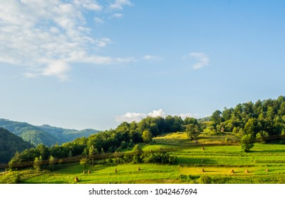 Bright rolling countryside around a farm in the morning light. Picturesque day and gorgeous scene. Location place Carpathian, Ukraine, Europe.