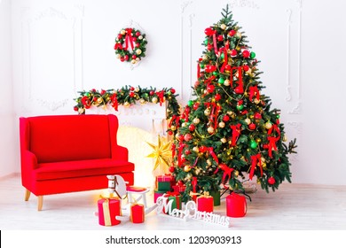 bright room with a beautiful Christmas tree, a fireplace and a red sofa