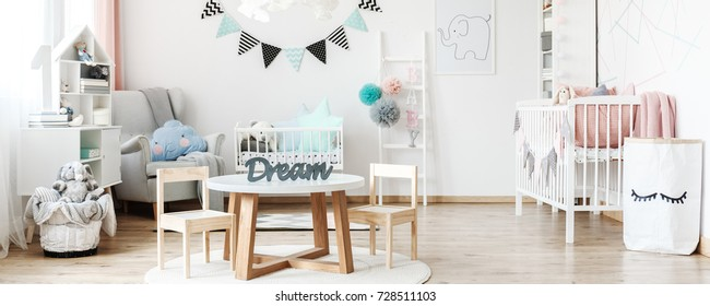 Bright room with cute decorations prepared for newly born baby