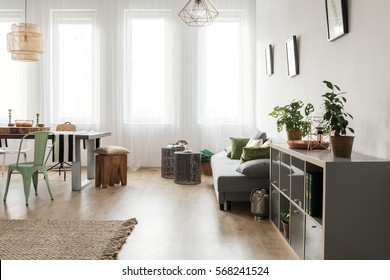 Bright room with dining area and sofa