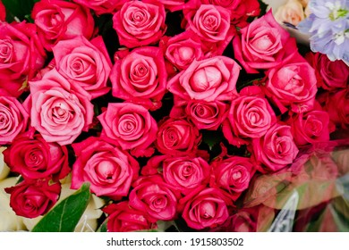 bright roses in a bouquet. Flowers are a traditional beautiful gift for wedding, birthday, Valentine's Day. Flower shop. Florist