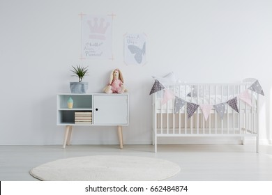Bright scandi baby room with decorations and toys