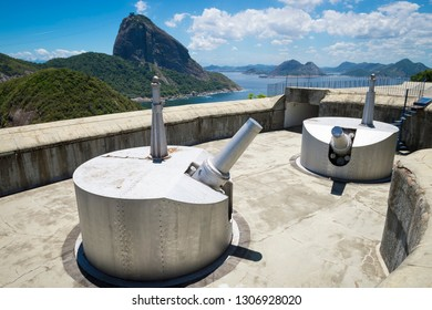 Bright scenic overlook of Sugarloaf Mountain and the Bahia de Guanabara  with decommissioned artillery guns in the foreground in Rio de Janeiro, Brazil