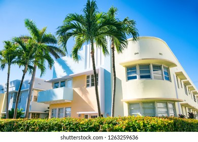 Bright scenic view of classic 1930s Art Deco architecture in South Beach, Miami, Florida with palm trees and blue sky