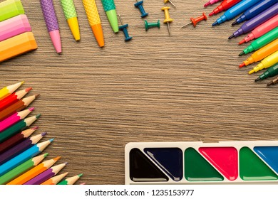 Bright school accessories, stationery on a wooden background. View from above