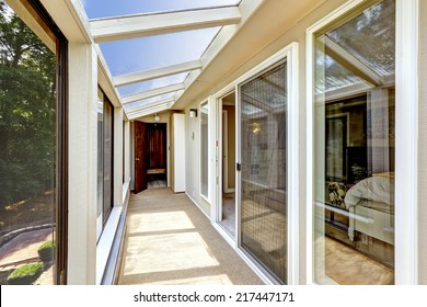Bright screened deck with carpet floor and glass roof. Entrance to bedroom