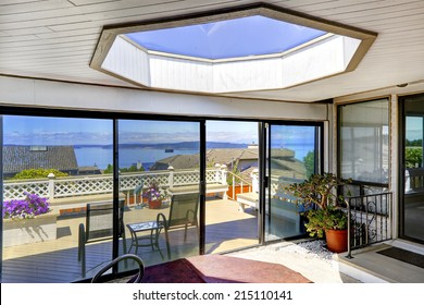 Bright screened deck with jacuzzi and big skylight