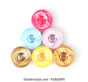 Bright sewing buttons isolated on white