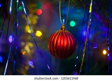 Bright shiny ball hanging on a christmas tree