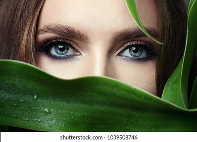 bright shiny eye makeup in glossy treatment. Elegant make-up. Blue eyes