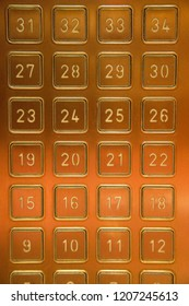 Bright, shiny, gold building or hotel elevator touchpad panel to select your hotel floor.  Modern technology employs a simple press of a number.
