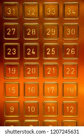 Bright, shiny, red gold colored building or hotel elevator touchpad panel to select your hotel floor.  Modern technology employs a simple press of a number.