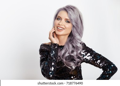 Bright smiling woman with curly silver hair in shining dress with sequins. Isolated on a light background.