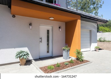 Bright space - a front door and a garage of a modern villa