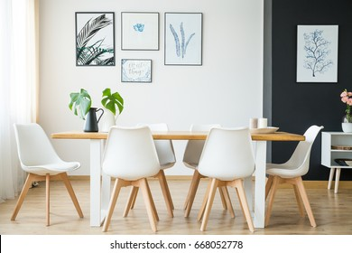 Bright spacious dining room with wooden big table - Shutterstock ID 668052778