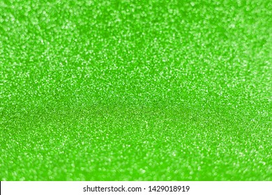 Bright sparkle green background. Holiday and festive concept. New year, Christmas, Wedding Day, Birthday.