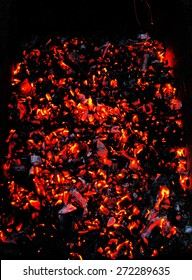 Bright sparkling embers in a brazier as background