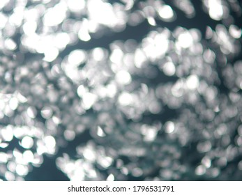 Bright sparkly white circles bokeh background.