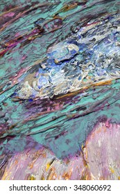 bright spots of paint on the palette