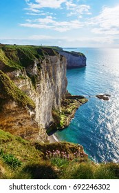 Bright spring and amazing rocky coastline of Etretat, Normandy, France, Europe