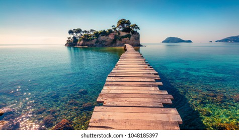 Photo of Bright spring view of the Cameo Island. Picturesque morning scene on the Port Sostis, Zakinthos island, Greece, Europe. Beauty of nature concept background.