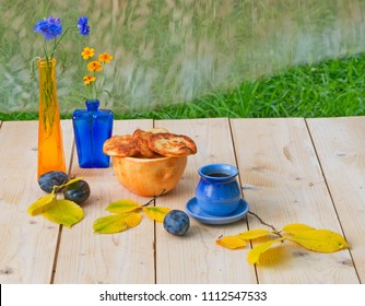 Bright still life in yellow and blue on the summer terrace.