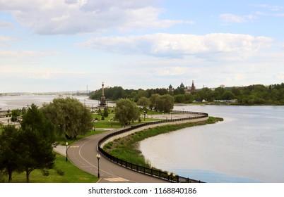 Bright summer day in the Strelka of Yaroslavl Beautiful landscaping of the Park on the embankment of the Volga and Kotorosl in Yaroslavl. the Temple complex in Korovniki