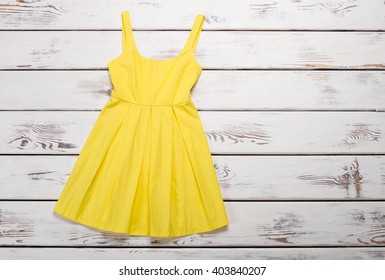Bright summer dress. Trendy yellow sarafan.