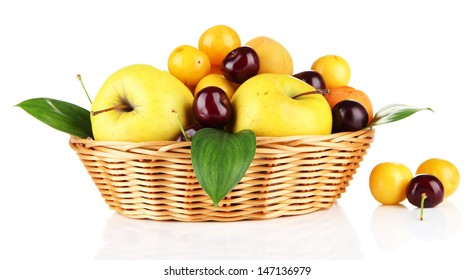 Bright summer fruits in basket isolated on white