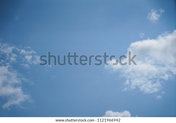 Bright summer light blue sky background with free form floating white cloud as per imagination on sunshine day, Turkey