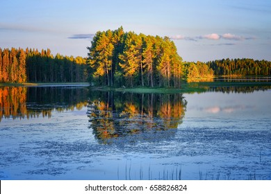 Bright summer sunset over the lake in the woods, Sweden, Dorotea