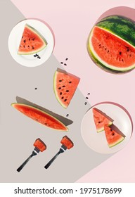 Bright summer table scene with various slices of watermelon. Creative arrangement against pastel pink and grey background. Summer flat lay.