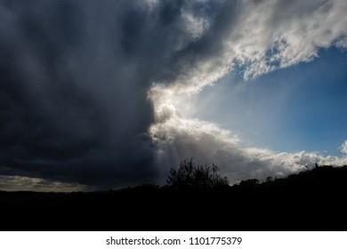 Bright sun behind beautiful cloudscape