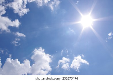 Bright sun and blue sky and clouds