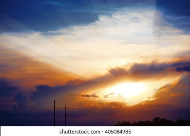 Bright sun in the blue sky with clouds. Brightly sunlight. Sunny day. Concept if freedom.