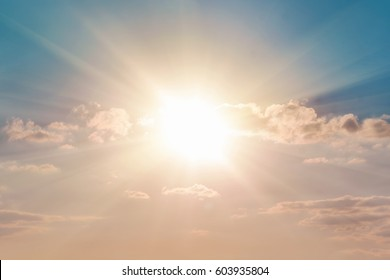 Bright sun in the blue sky with clouds