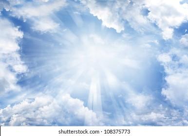 Bright sun in cloudy sky. Copy space