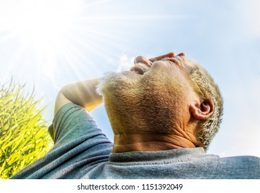 in bright sun and high temperatures, a man sees the sky