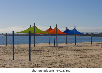 Bright sun shades on Koombaba Beach, Bunbury, South Western Australia  on a cloudy morning in early winter add a splash of color to the sandy shore.